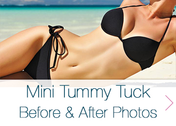 the torso of a woman with a flat stomach wearing a black bikini laying on a beach
